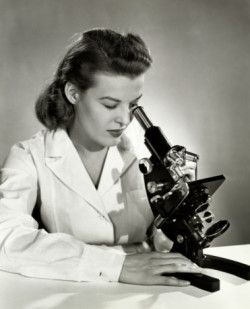 40s woman with microscope