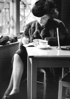 40s woman writing